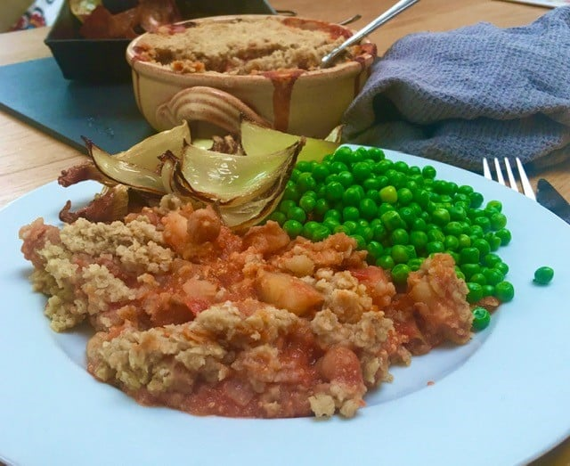 close up of chickpea crumble, on a plate, with sides