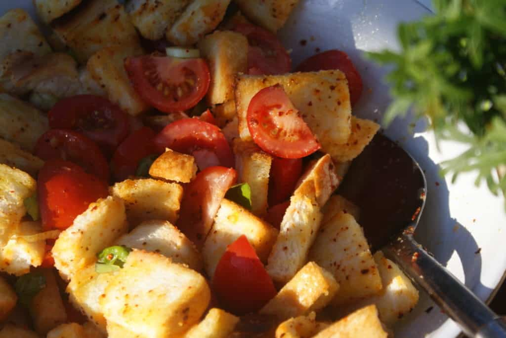 summer tomatoes in a vegan panzanella