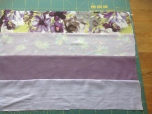fabric strips sewn together for a patchwork quilt