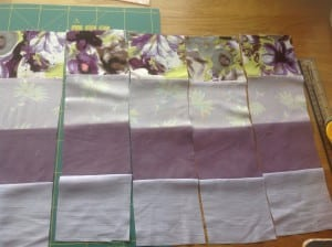 cut up fabric strips for patchwork quilt