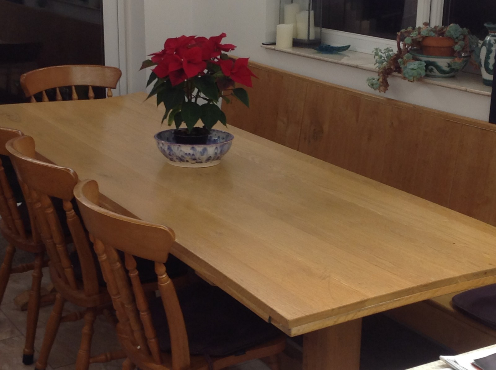 An oak table, hand made by the bloggers husband. Beautiful colour Andy big enough for a family lunch