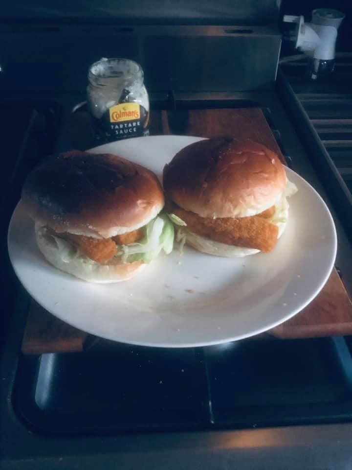 fish fingers with lettuce and tartar sauce in a brioche bun
