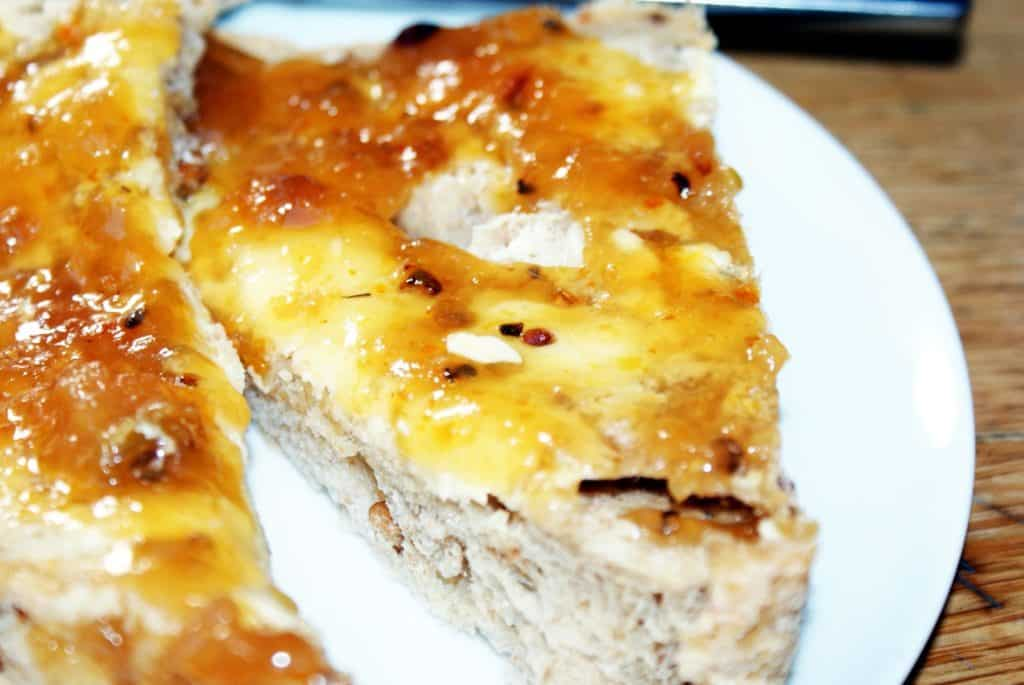 French apple jam on a slice of bread and butter