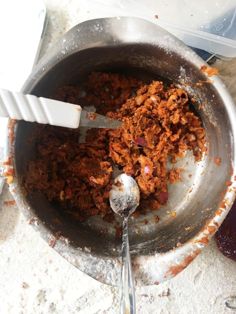 spiced lentil balls - mixture being made into balls