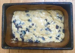 fruit loaf - unbaked mixture in lined baking tin