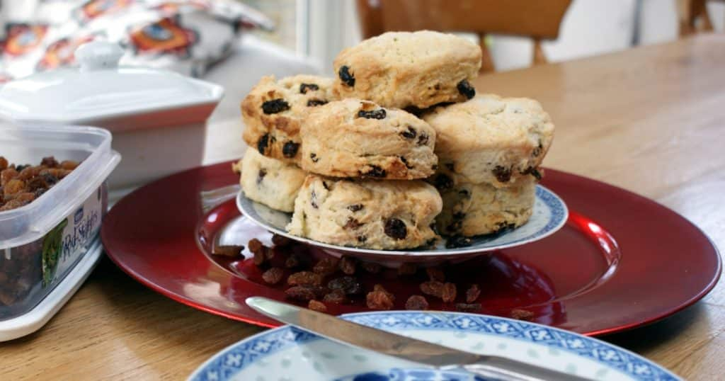 Fruit scones on a blue patterned plate on a red charger