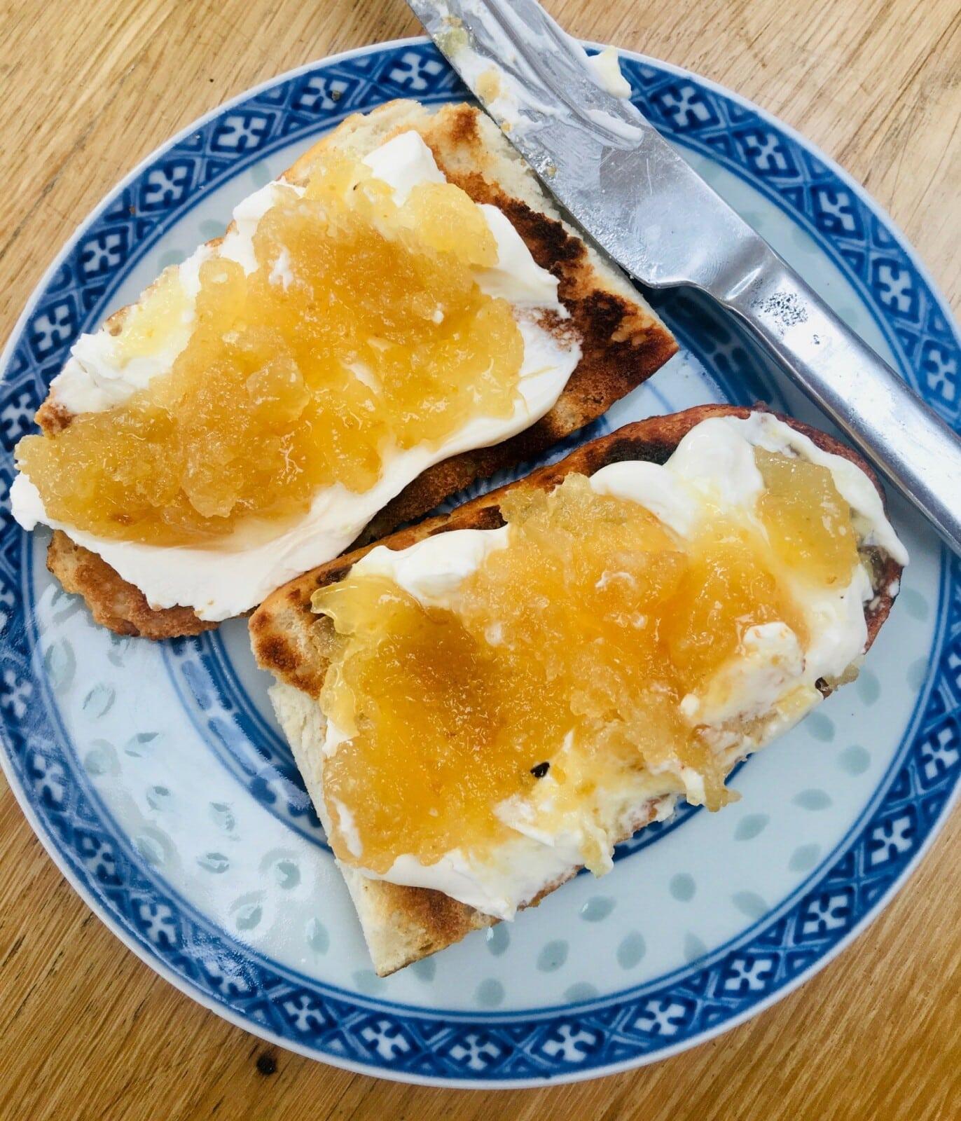 Lemon Peel Jam on toast with cream cheese, on blue patterned plate