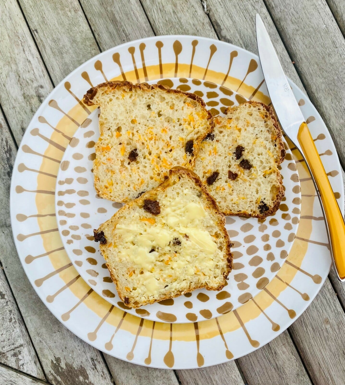 carrot and sultana loaf - slices on plate